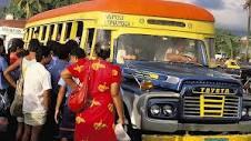 Passengers boarding bus.