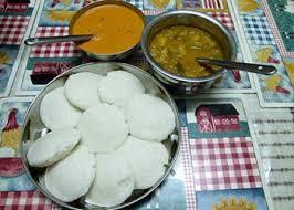 Vadai with rasam and dahl
