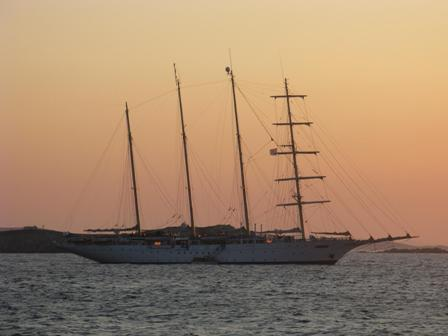 Star Clipper anchored off Mykonos at sunset.