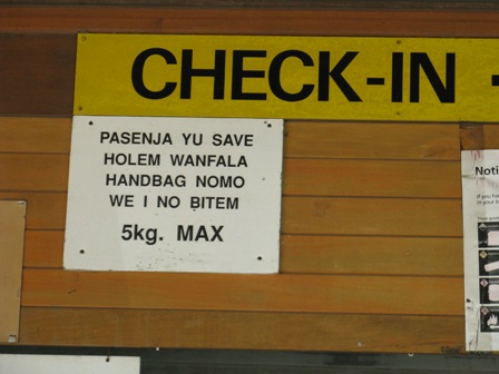 Tanna Island Airport check in sign.