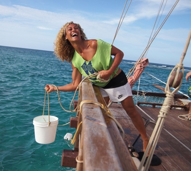 Crew member Erena Young hauling bucket of dunny water