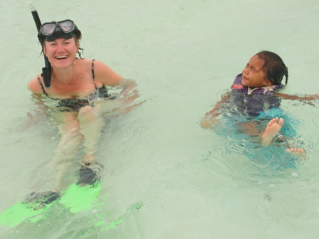 Gaynor Stanley PR expert from PEPR Publicity and Elani of Wet n Wild enjoying a moment in Aitutaki's splendid lagoon