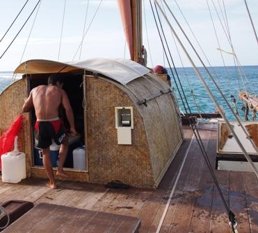 Crew member Malik entering Marumaru Atua galley