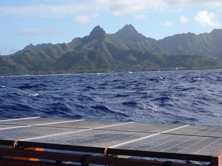 Solar panels on Marumaru Atua with Rarotonga receding in the distance