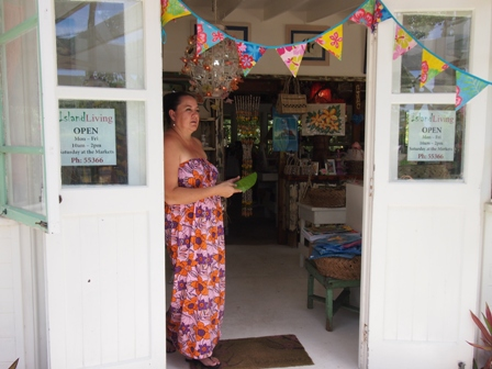 Minar Purotu Henderson at entrance to her Island Living shop