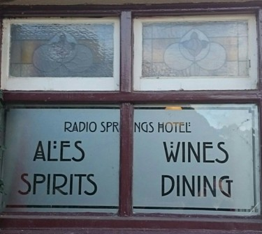 Lyonville Radio Springs pub window