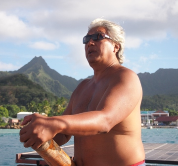 Master Navigator Tua Pittman at the tiller of the Marumaru Atua