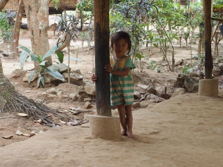 Shy young girl at Mon village