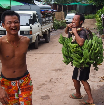 Smiles under bananas at Yangon wharf
