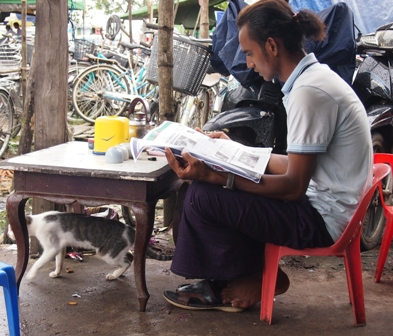Myanmar cafes offer tiny plastic chairs, useful when waiting for rain to cease