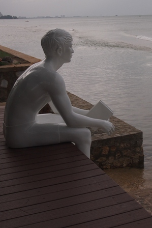 Seated statue at Let's Sea Al Fresco Resort