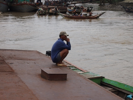 Lone worker on Yangon wharf