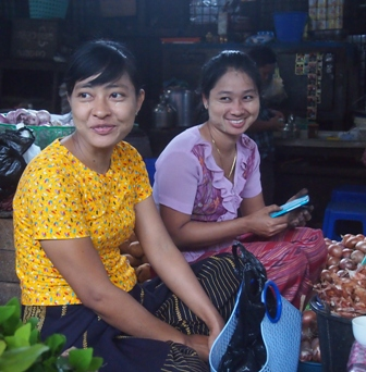 Young women wearing 'thanaka' at Shwe Dagon market