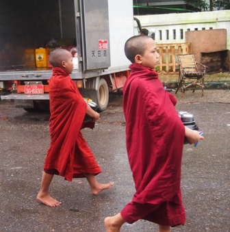 Young monks collecting alms near Shwe Dagon Pagoda
