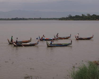 Boats at U Bein bridge lake