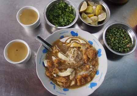 Bowl of Mohinga at Shwe Ye La cafe in Mandalay