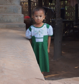 Nwe Nyein village child in her school uniform