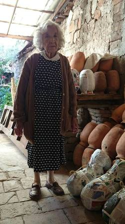 Ajijic shop owner selling ceramic pots