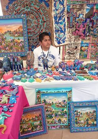 Feria artist with paintings