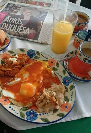 Huevos Ranchers, fresh orange juice and cinnamon infused coffee in a Guadalajara cafe