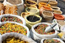 Bags of spices and dried legumes for sale
