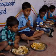 Children eating, giving thanks