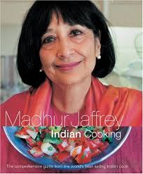 Madhur Jaffrey with one of her cookbooks