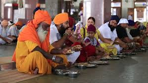 Sikhs eating in temple