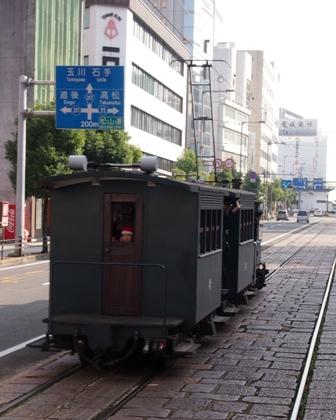 Botchan train trundling along Matsuyama street