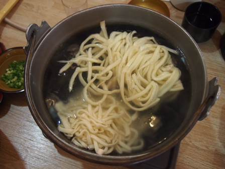 Udon cooking in dashi