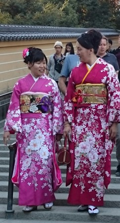 Two tourists dressed in traditional kimono