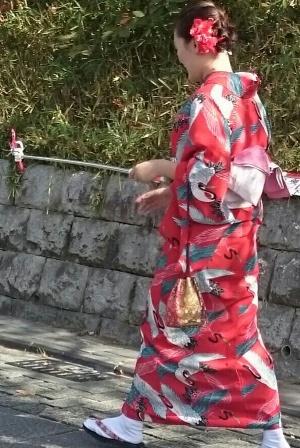 Kimono clad tourist with selfie stick