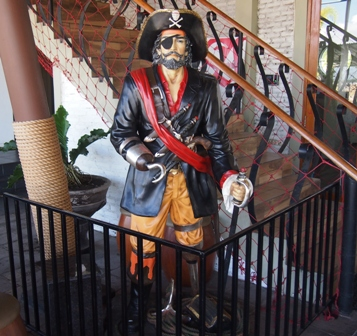 Pirate in front of marina restaurant Manado