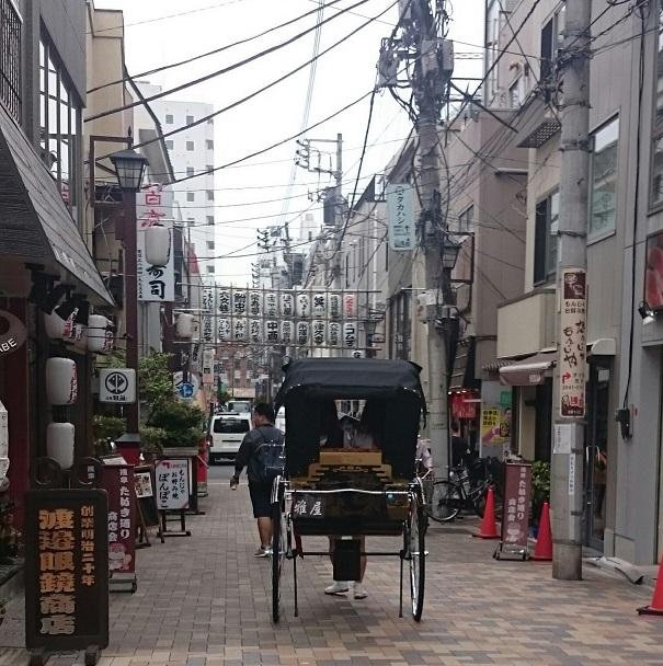 Asakusa street scene with rickshaw